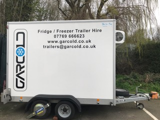 Garcold Trailer image with contact information on the side